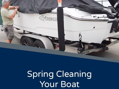 Spring Cleaning Your Boat - Image of a person removing the mooring cover from a Crevalle boat